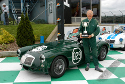 Joe Tierno and trophy with his 1957 MGA