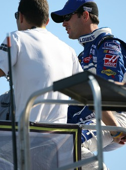 Jimmie Johnson watches practice action from atop his hauler