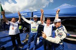 Marcus Gronholm and Mikko Hirvonen celebrate