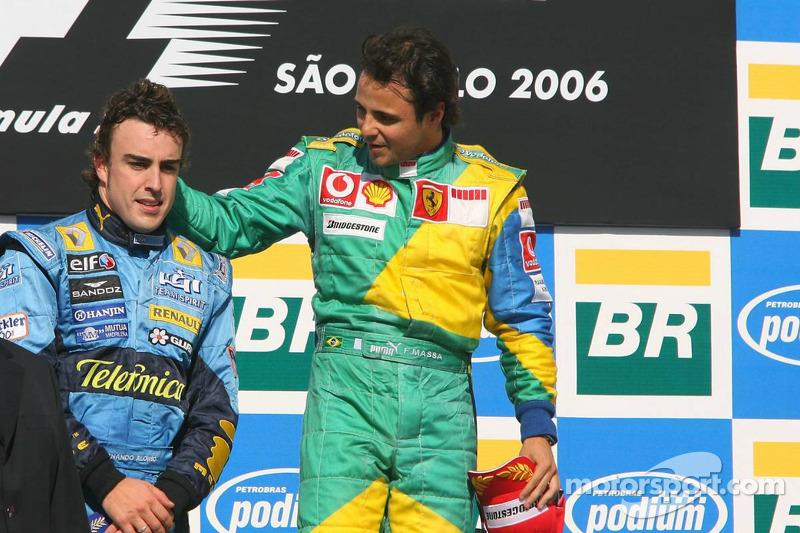 Podium: race winner Felipe Massa with 2006 World Champion Fernando Alonso
