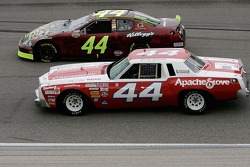 Terry Labonte and his son Justin driving a replica of Terry's first race car lead the field on a pace lap