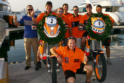 Bike category winner Marc Coma celebrates with Jordi Viladoms