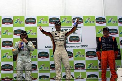 Podium: race winner Jorg Muller with Yvan Muller and Tom Coronel