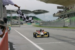 Nico Hulkenberg takes the chequered flag
