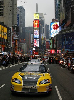 The Sprint Nextel car leads the top 10 on their Victory Lap through New York City