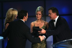 NASCAR Chairman and CEO Brian France presents Jimmie Johnson with his championship ring and a diamond necklace to Chandra Johnson