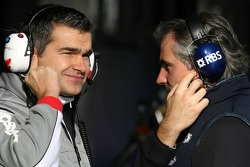 A Toyota Racing engineers talks with a WilliamsF1 Team engineer