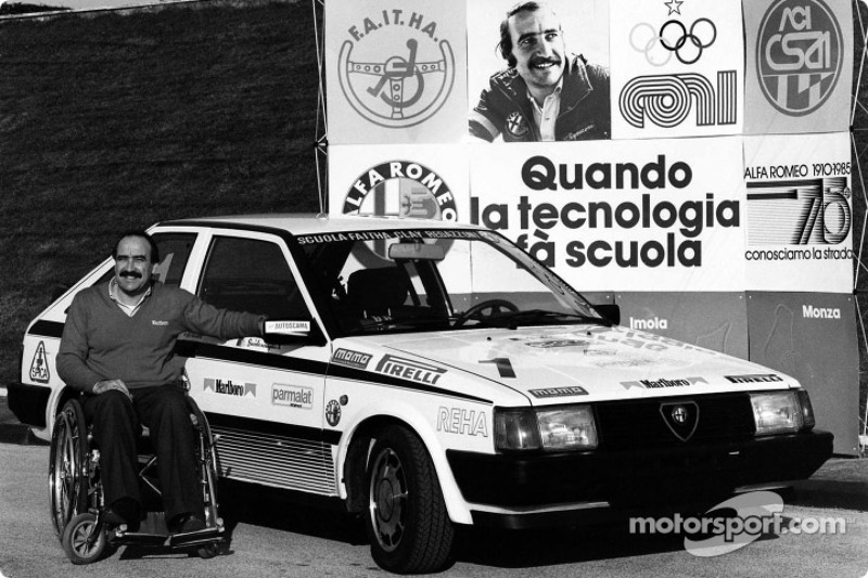 Clay Regazzoni in a wheel-chair at his Alfa Romeo sponsored racing driver school for handicapped peo