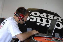 A Roush Racing crew member checks the data from testing