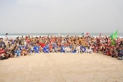 The KTM team celebrates on the beach