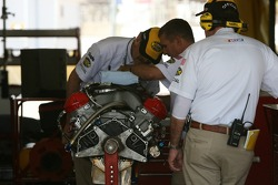 NASCAR officials have a complete inspection of the motor of the NAPA Toyota of Michael Waltrip