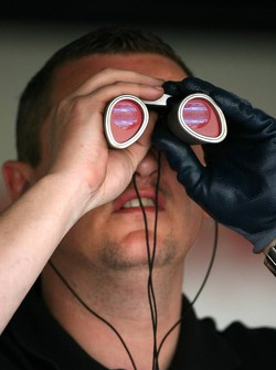 A Honda Racing F1 Team mechanic looks into the grandstand