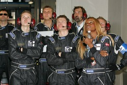 Team Markland Racing team members watch the end of the race