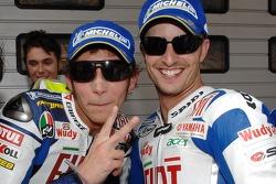 Pole winner Valentino Rossi celebrates with Colin Edwards