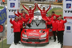 Podium: winners Sébastien Loeb and Daniel Elena celebrate with Citroen Total WRT team members