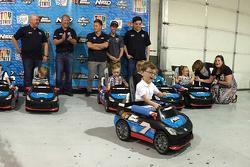 Go Baby Go evento del patrocinador de Tommy Baldwin Racing