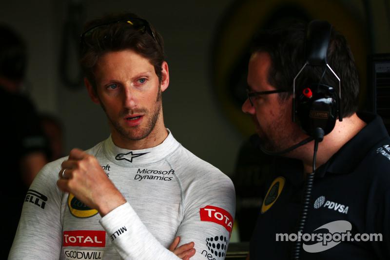 Romain Grosjean, Lotus F1 Team, mit Julien Simon-Chautemps, Lotus F1 Team, Renningenieur