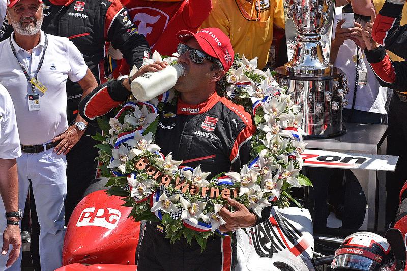 Race winner Juan Pablo Montoya, Team Penske Chevrolet drinks the milk