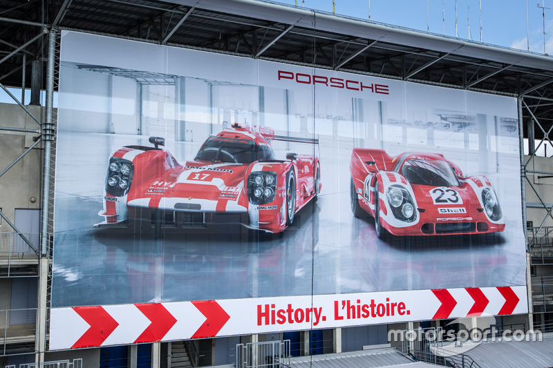 Porsche advertising banner overlooking the paddock