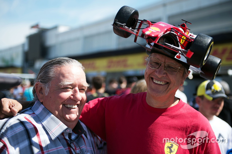 Ferrari fan with a car on his head