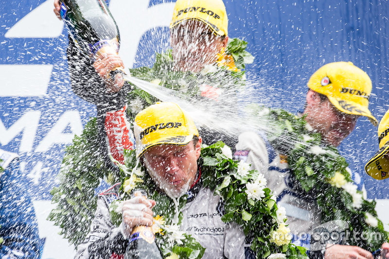 LMP2 podium: drivers celebrate with champagne