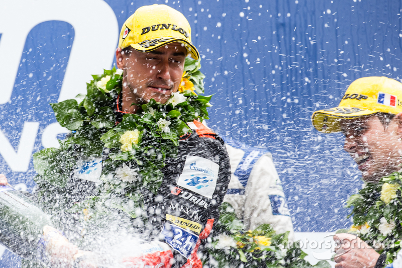 LMP2 podium: G-Drive Racing Roman Rusinov celebrates with champagne