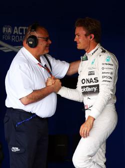 Nico Rosberg, Mercedes AMG F1 merayakan his second position in qualifying parc ferme bersama Pat Behar, FIA