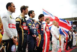Pastor Maldonado, en Romain Grosjean, Lotus F1 Team  op de grid
