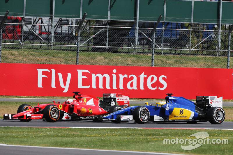 Kimi Raikkonen, Ferrari SF15-T, dan Marcus Ericsson, Sauber C34