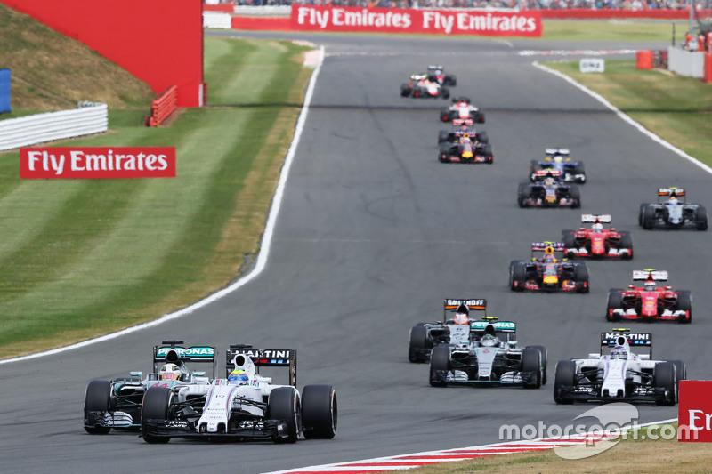 Felipe Massa, Williams FW37 leads Lewis Hamilton, Mercedes AMG F1 W06