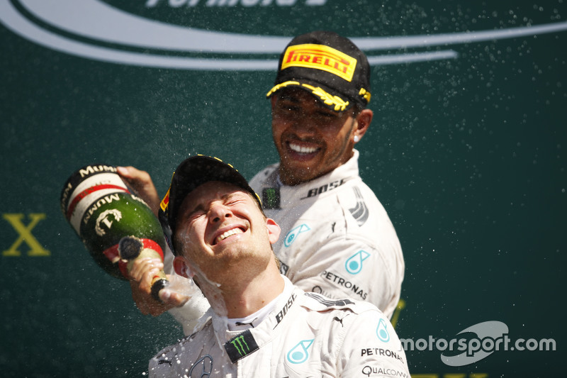 Race winner Lewis Hamilton, Mercedes AMG F1 celebrates on the podium with team mate Nico Rosberg, Me