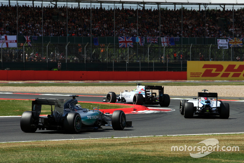 Felipe Massa, Williams FW37 leads the race from Valtteri Bottas, Williams FW37 and Lewis Hamilton, M