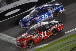 Cole Whitt, Front Row Motorsports Ford and Kurt Busch, Stewart-Haas Racing Chevrolet