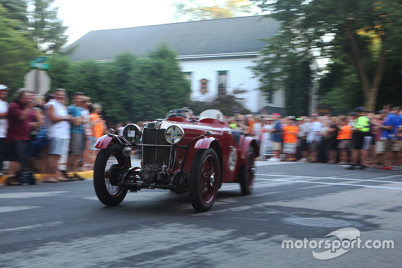 Race cars return to the track after the concours  1933 MG/J3
