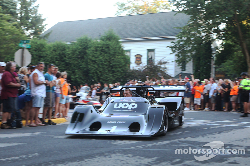 Race cars leave town after the concours 1974 Shadow DN4