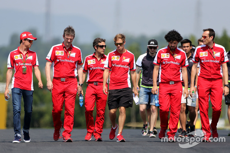 James Allison, Ferrari Chassis Technical Director and Sebastian Vettel, Scuderia Ferrari