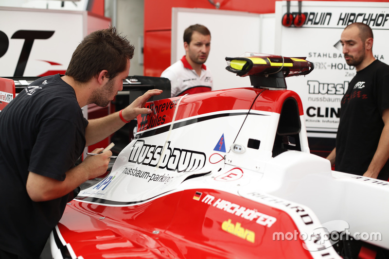 ART Grand Prix apply a '#Forever Jules' sticker to Marvin Kirchhofer's car