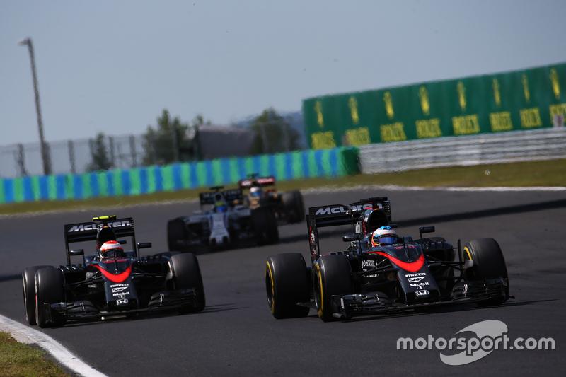 Fernando Alonso, McLaren MP4-30 leads Jenson Button, McLaren MP4-30
