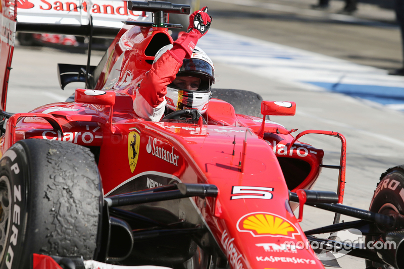 Race winner Sebastian Vettel, Ferrari SF15-T celebrates in parc ferme