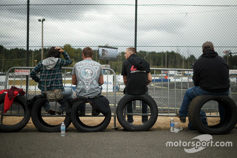 Fans sit on tires