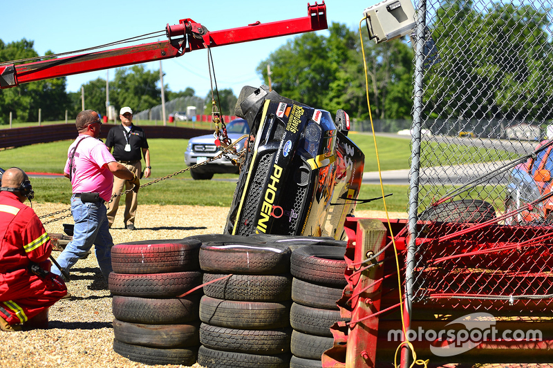 Safety crews work after a hard crash for #35 Phoenix American Motorsports Ford Mustang Boss 302: Preston Calvert