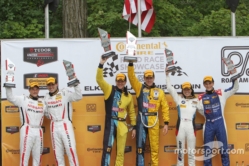 Podium: race winners Matt Plumb, Hugh Plumb, second place BJ Zacharias, Brad Jaeger, third place Tre