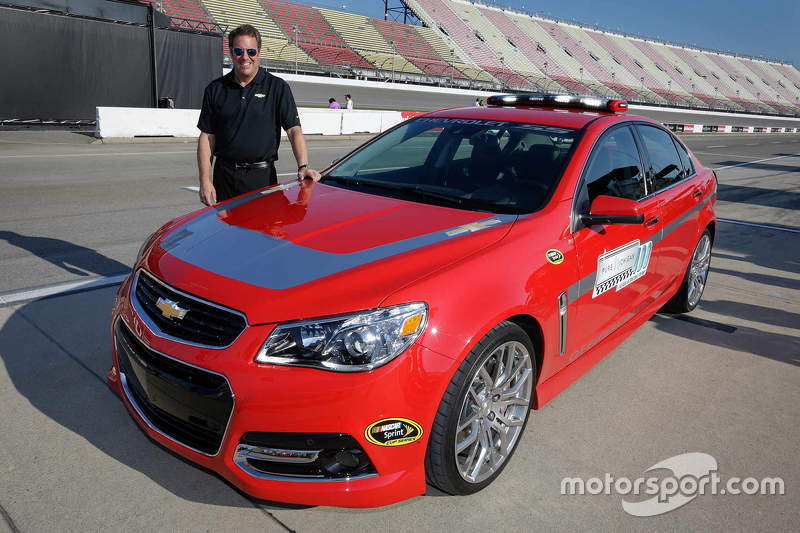 General Motors Executive Vice President of Product Development Mark Reuss with the Chevrolet SS pace car