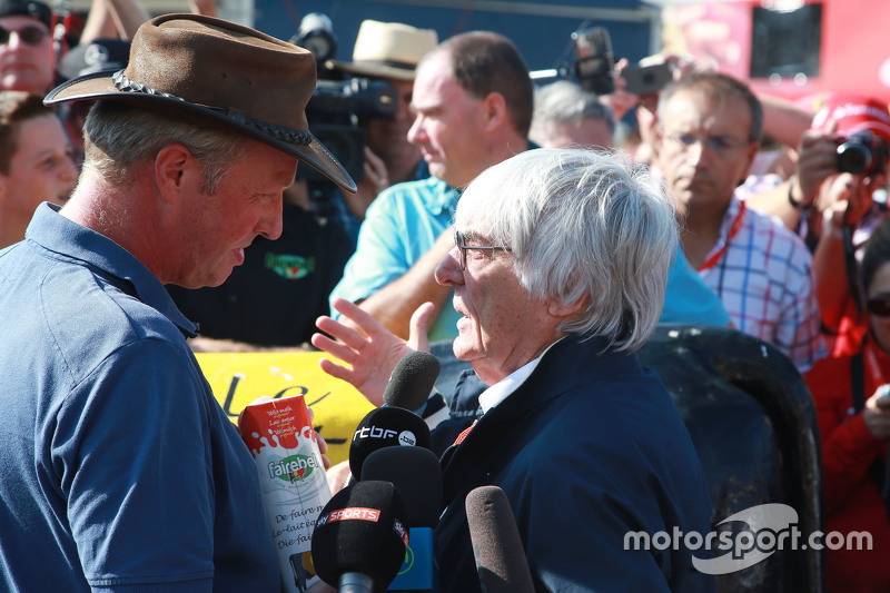 Bernie Ecclestone, meets Belgian farmers who protest with a cow in a campagin for a fair price for t