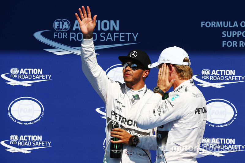 (L to R): Lewis Hamilton, Mercedes AMG F1 celebrates his pole position in parc ferme with second placed team mate Nico Rosberg, Mercedes AMG F1