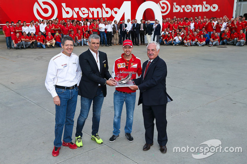 Sebastian Vettel and Maurizio Arrivabene, Ferrari Team Principal at Brembo factory