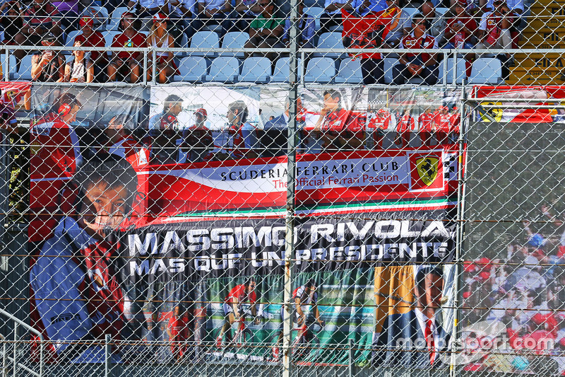 Ferrari fans with a banner for Massimo Rivola, Ferrari Sporting Director