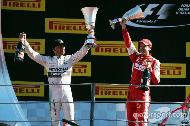 (L to R): Race winner Lewis Hamilton, Mercedes AMG F1 celebrates with second placed Sebastian Vettel, Ferrari on the podium