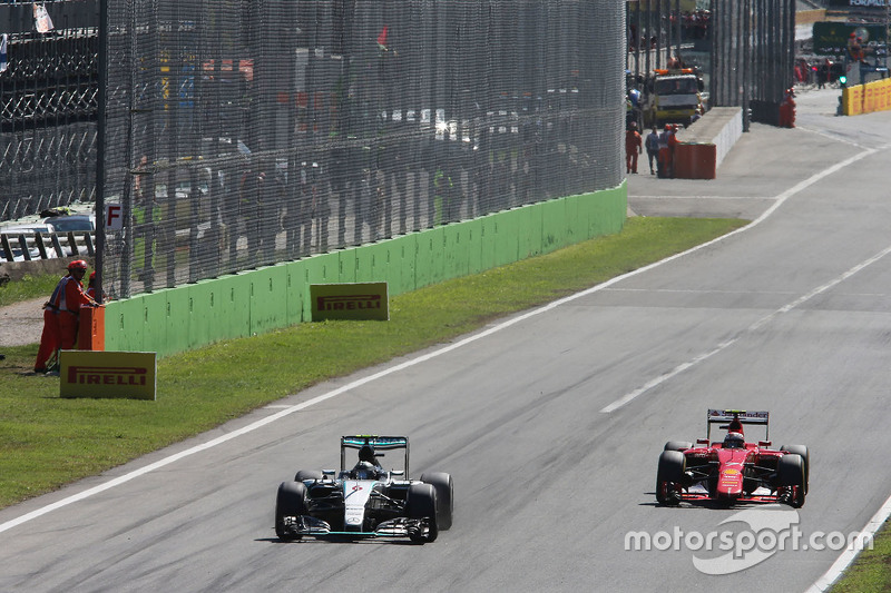 Nico Rosberg, Mercedes AMG F1 W06 and Kimi Raikkonen, Ferrari SF15-T
