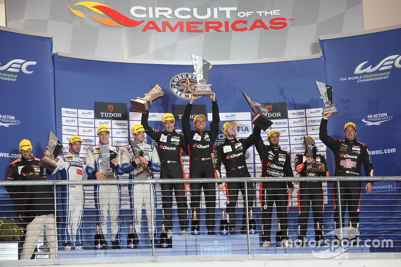 LMP2 podium: winners Roman Rusinov, Julien Canal, Sam Bird, G-Drive Racing, second place Matthew How